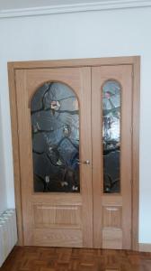 Puerta interior roble 301 tm ,vidriera emplomada