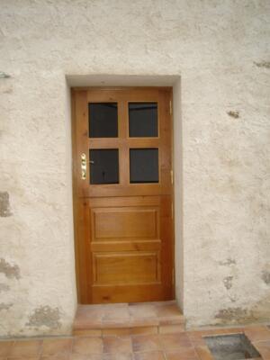 Puerta entrada exterior madera partida